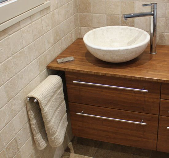 Meuble bambou density et vasques pierre naturelle - Plan de toilette salle de bain ...
